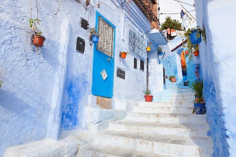 An alleyway in the medina, Chefchaouen, Morocco. Colourful cities in the world